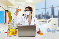 Doctor analyzing yellow solution at the hospital Royalty Free Stock Photo