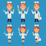 Doctor And Nurse Holding Enema Syringe Thermometer Royalty Free Stock Photos