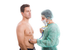 Doctor And Patient At The Examination Royalty Free Stock Photography