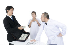 Doctor angry and refused to receive no more money of businessman.  Stock Images
