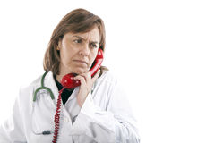 The doctor answers Royalty Free Stock Photo