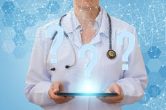 Doctor answers questions on the network . Royalty Free Stock Images