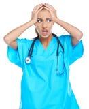 Doctor apenado que lleva a cabo su cabeza Imagen de archivo libre de regalías