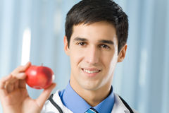 Doctor with apple Stock Photos