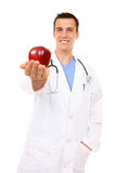 Doctor with Apple (Focus on Face). Handsome, happy smiling doctor with apple, isolated on white (Focus on Face stock image