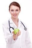 Doctor with an apple in her hand. Royalty Free Stock Image