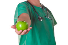 Doctor with an apple on his hand Stock Photography