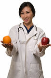 Doctor with apple and orange Stock Images