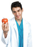 Doctor with an apple Royalty Free Stock Photography