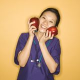 Doctor and apples. Royalty Free Stock Image