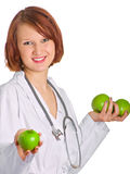 Doctor with apples. In her hands Royalty Free Stock Photos