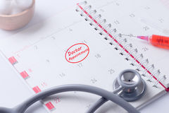 Doctor appointment on paper of organizer Royalty Free Stock Photos