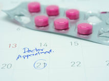 Doctor appointment remainder on calendar Royalty Free Stock Image