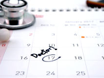 Doctor appointment remainder on calendar. The word `Doctor!` write on calendar Stock Image