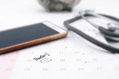 Doctor appointment remainder on calendar. The word `Doctor!` write on calendar Royalty Free Stock Images