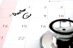 Doctor appointment remainder on calendar. The word `Doctor` write on calendar Royalty Free Stock Images