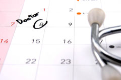 Doctor appointment remainder on calendar. The word `Doctor` write on calendar Stock Photos
