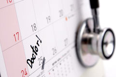 Doctor appointment remainder on calendar. The word `Doctor!` write on calendar Stock Photos