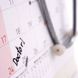 Doctor appointment remainder on calendar. The word `Doctor!` write on calendar Royalty Free Stock Photography