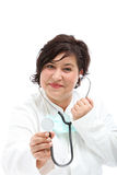Doctor approaching with a stethoscope Stock Photography