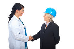 Doctor and architect women shaking hands Stock Images