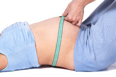 Doctor arms measuring length of lying abdomen pregnant woman Royalty Free Stock Images
