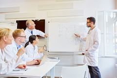 Doctor as instructor presenting. And training during seminar stock images