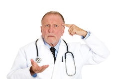 Doctor asking, you crazy? Stock Image