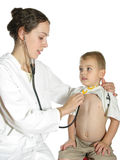 Doctor assessing child Stock Photography