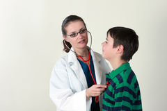 Doctor assessing patient by stethoscope Stock Image