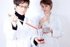 Doctor with Assistant - experimenting Royalty Free Stock Images