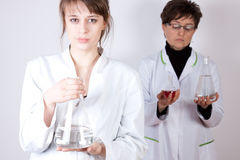 Doctor with Assistant - experimenting Stock Photography