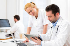 Doctor and an assistant working together at the hospital Stock Photo