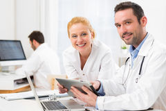 Doctor and an assistant working together at the hospital Stock Image