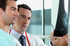 Doctor and assistant with x-ray Royalty Free Stock Image