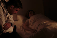 Doctor assisting patient at night Royalty Free Stock Photos