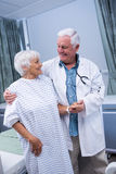Doctor assisting senior patient at hospital Royalty Free Stock Photos