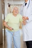 Doctor Assisting Senior Woman Stock Photos