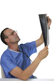 Doctor att se röntgenstrålen på en vit bakgrund royaltyfria foton