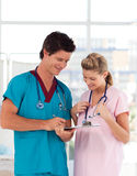Doctor with attractive nurse in hospital Royalty Free Stock Photos