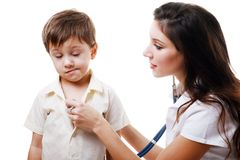 Doctor auscultating a child Stock Image