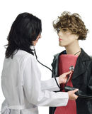 A doctor auscultating the mannikin Stock Photos