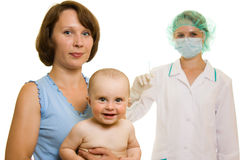 Doctor with a baby Stock Images