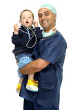 Doctor and baby. Doctor in uniform with baby and stethoscope isolated in white Royalty Free Stock Image