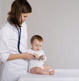 Doctor and baby Royalty Free Stock Photos