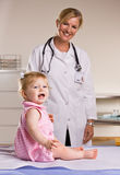 Doctor and baby girl in doctor office Royalty Free Stock Photo