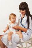 Doctor with baby girl Stock Images