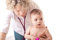 Doctor and baby patient. Stock Images