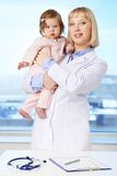Doctor with baby Royalty Free Stock Photography