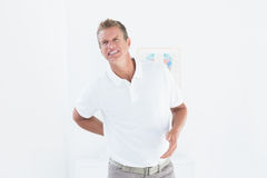 Doctor with back pain Royalty Free Stock Photos